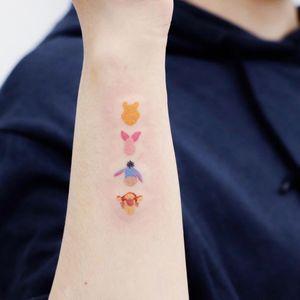 Tattoo by Haeny #Haeny #winniethepoohtattoos #winniethepooh #childrensbooks #cartoon #animated #disney #disneytattoo #color #minimal #small #eeyore #piglet #tigger