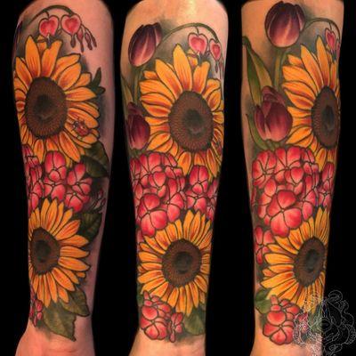 Flowers on the forearm. #sunflower #flowers #flower #neotraditional #tulip #color #illustrative #forearm #milwaukee #Wisconsin #chicago #tattooartist #nature #tattooart #tattoo