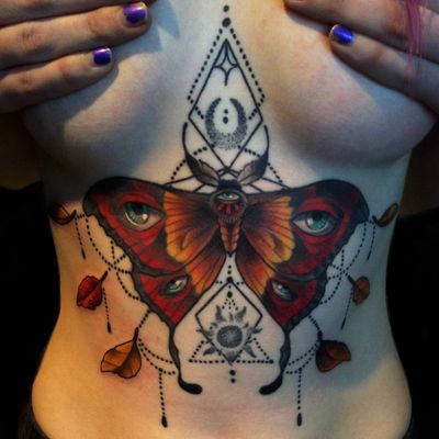 Moth. #moth #tattooartist #trippy #eye #neotraditional #color #nature #magic #milwaukee #Wisconsin #chicago #insect #bug #sternum #chest #leaves #geometric #geometry #tattooart #tattoo