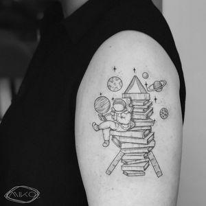 Reading #astronaut #tattooartist
