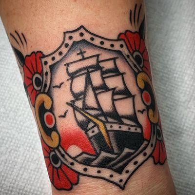 Tattoo by @zimovan. #brighttattoos #bright #BoldTattoos #brightandbold #ship #shiptattoo #flower #flowers #sunset #traditional #traditionaltattoo #ashevillenc #nctattooers