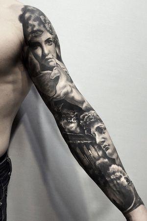 Black and grey long sleeve #statuesleeve #statuetattoo #naturalhealed #goodhealed #clocktattoo #horsetattoo