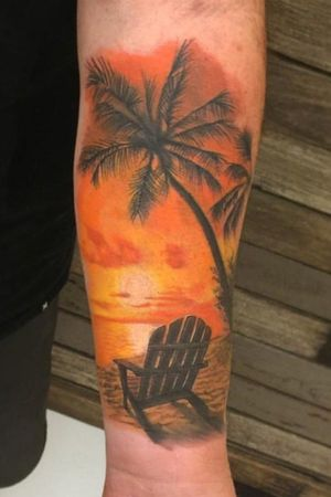 Life goals ! Did this amazing sunset over the beach tattoo on a solid client