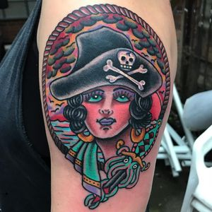 Tattoo by Robert WIlden aka Deathsure #RobertWilden #Deathsure #color #traditional #psychedelic #ladyhead #pirate #squid #dagger #skull #skullandcrossbones