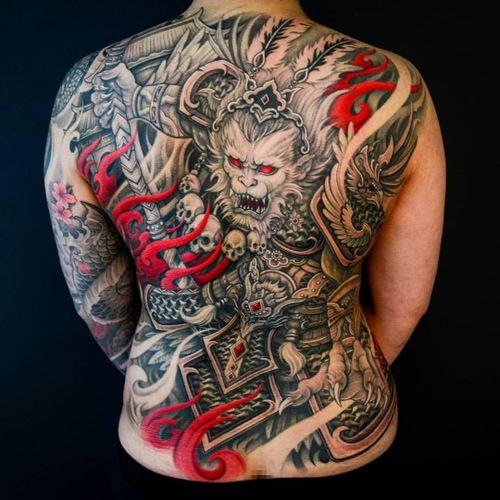 Tattoo by Winson Tsai #WinsonTsai #ChineseTattoos #ChineseNewYear #LunarNewYear #Chinese #chineseart #China #monkeyking #monkey #skulls #backpiece #backtattoo #fire #phoenix #sword