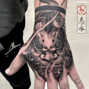 Tattoo by Zhiyongma #Zhiyongma #ChineseTattoos #ChineseNewYear #LunarNewYear #Chinese #chineseart #China #shishi #foodog #blackandgrey #handtattoo