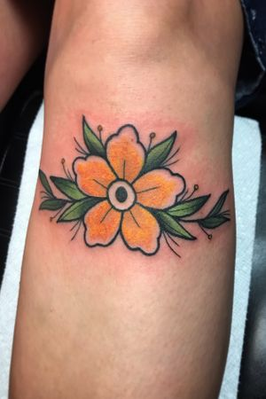 Traditional forget me not flower under the knee