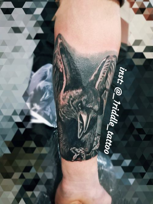 Silver and black tattoo