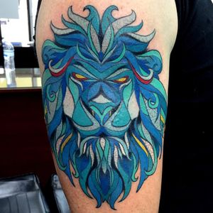 Heres a stylized lion head. This tattoo was done on an upper arm. #lion #mandala #color