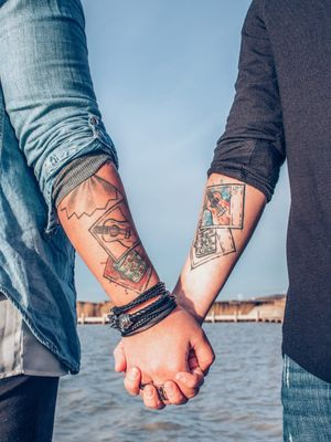 Tattooist unknown - matching couples tattoos on Ivy Rachel and her husband #couplestattoos #valentinesday #love #couple #heart #matchingtattoos
