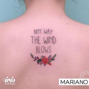 Tattoo by Mariano of Iris Tattoo #Mariano #IrisTattoo #queentattoos #queen #freddymercurytattoo #freddymercury #bohemianrhapsody #rockandroll #musictattoo #lettering #flower #floral #minimal