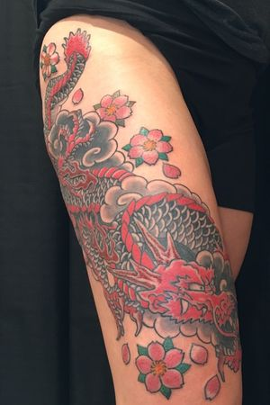 Japanese dragon and cherry blossoms by Carl Hallowell for Ms G... #CarlHallowell #traditionaljapanese #japanese #irezumi #dragon #womenwithtattoos #thightattoo #cherryblossom #sakura #fire