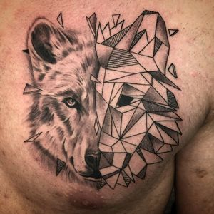 Geometrical/realism wolf on chest. About a year ago.