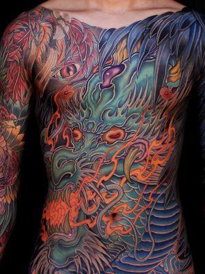 Tattoo by Shi Ryu #ShiRyu #Awesometattoos #besttattoos #tattoodoapp #appartists #trendingtattoos #toptattoos #tattoodoappartists #color #japanese #bodysuit #dragon #fire