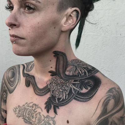 Tattoo by Javier Betancourt #JavierBetancourt #necktattoos #necktattoo #neck #jobstopper #blackandgrey #cobra #snake #reptile #animal #chrysanthemum #illusttrative