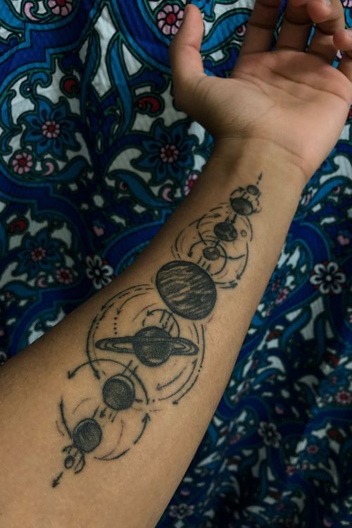i have a thing for space and astronomy so i chose the solar system to be my first tattoo.