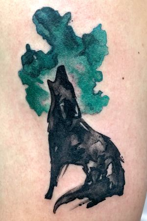 Inky howling wolf