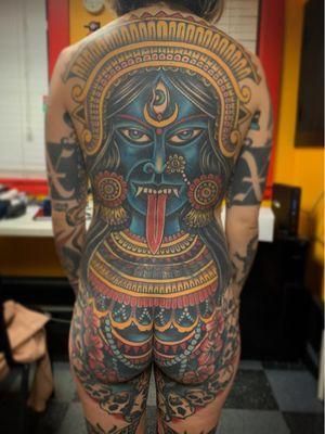 Tattoo by Chad Koeplinger #chadkoeplinger #Kalitattoos #kalithedestroyer #goddessKali #Hindu #HinduGoddess #deity #crown #thirdeye #color #traditional #skull #flower #floral