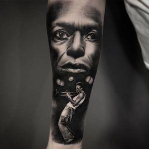 Black and white Miles Davis realism half sleave on forearm.