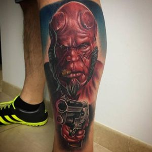 Hellboy colour realism tattoo on leg.