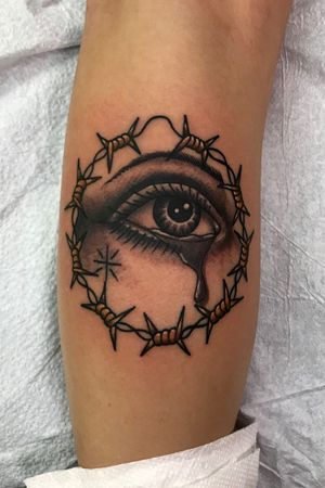 Drawn on black and grey crying eye and barb wire hoop earring