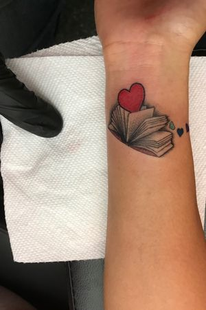 The smallest book ive ever tattooed. #tiny #book #small #micro