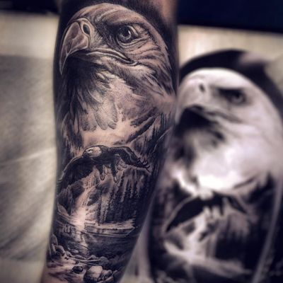 Tattoo by Anton Dainecko #AntonDainecko #openbookings #cooltattoos #blackandgrey #eagle #feathers #bird #landscape #mountains #realism #realistic #hyperrealism