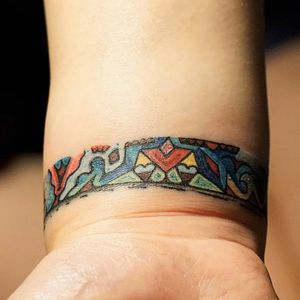 Wrist band tattoo Done on girl she is DJ and wanted a reminder about the perfect night she did an amazing dj set at some party. #wristtattoo #firetattoo #colortattoo #vsyoba #band #yellow #red #blue #lines #abstracttattoo #abstract #shapes #party #fun #cutetattoo #cute #dj #music #party