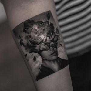 Tattoo by Inal Bersekov #InalBersekov #blackandgrey #realism #realistic #hyperrealism #portrait #lady #ladyhead #flower #magnolia #floral #light #lips