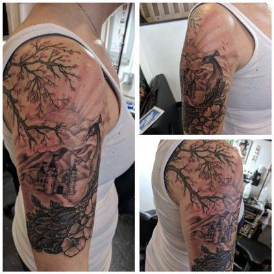#peacock #peacocktattoo #halfsleeve #blackandgrey #castle #tree #tattoosforwomen
