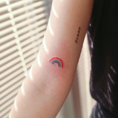 Tattoo by Nemo Tattoo #NemoTattoo #StPatricksDaytattoos #StPatricksDay #holidaytattoo #rainbow #color #tiny #small #minimal