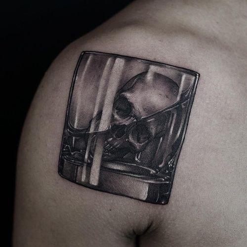 Tattoo by Gara Tattooer #GaraTattooer #StPatricksDaytattoos #StPatricksDay #holidaytattoo #blackandgrey #skull #glass #whiskey #alcohol #drink #liquor #death