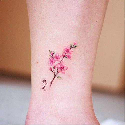 Tattoo by Vane Tattoo #VaneTattoo #flowertattoos #flowertattoo #flower #floral #nature #plant #color #watercolor #cherryblossom