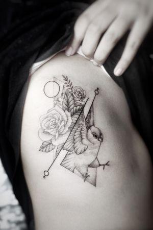 Girly tattoo on the rib