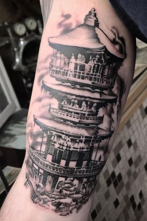 Black and grey fineline pagoda tattoo
