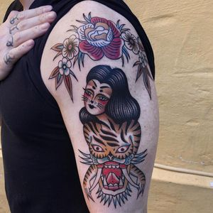 Tattoo by Cloditta #Cloditta #tattoodoapp #tattoodoappartist #tattooartist #tattooart #tattoodoappspotlight #traditional #tiger #lady #flowers #floral #mask #cat #catlady