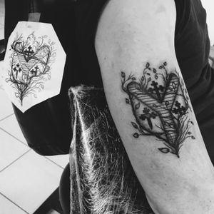 Family shield tattoo #blackandgray #shield #leafs #armtattoo #blackwork