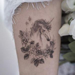 Tattoo by Goyo #Goyo #finelinetattoos #fineline #delicate #linework #illustrative #unicorn #horse #animal #stars #rose #flower #floral #leaves #plant