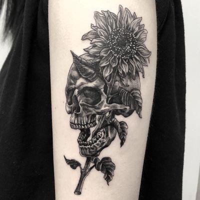 Skull + Sunflower. #blackwork #blackandgrey #linework #skull #sunflower #newschool #traditional #flower #arm #illson