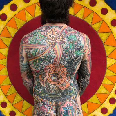 Tattoo by Chad Koeplinger #chadkoeplinger #SurrealTraditionalTattoos #Traditionaltattoos #surrealtattoos #surrealism #oldschool #AmericanTraditional #buddhism #skull #hindu #dragon #rainbow #tibetan #backpiece