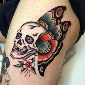 Tattoo by Andrea Guiilimondi #AndreGuilimondi #Londontattoo #London #Londontattooartist #londontattoostudio #UK #traditional #color #skull #butterfly #flower