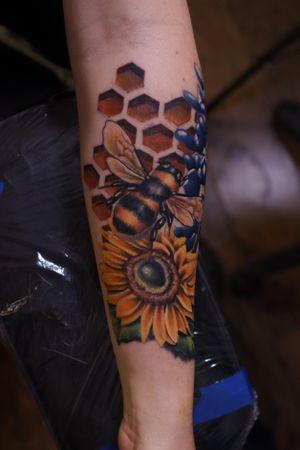 Bee, sunflower, and bluebonnet