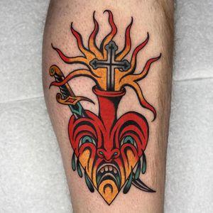 Tattoo by Luke Jinks #LukeJinks #Londontattoo #London #Londontattooartist #londontattoostudio #UK #color #traditional #heart #sacredheart #fire #sword #tears #cross #cryingheart