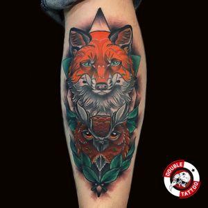 Fox with owl tattoo