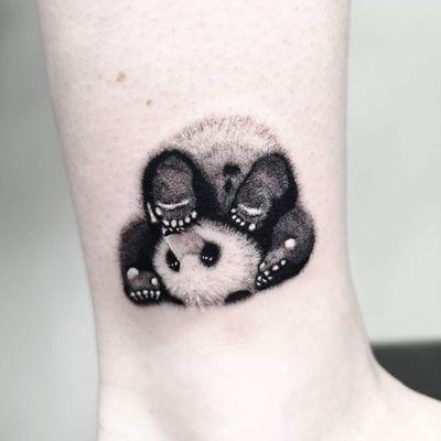 Panda / details ❤️🐼 Instagram: @nikita.tattoo #tattooartist #tattooart #blackworktattoo #blackwork #lineworktattoo #LineworkTattoos #linework #thinlinetattoo #fineline #dotwork #dotworktattoo #minimalism #minimalistic #minimalistictattoo #tattooideas #panda #pandatattoo #pandabear #smalltattoo #ankletattoo #stejatattoo #artistnikita