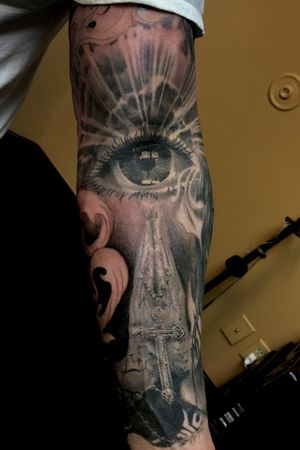 All seeing eye and praying hands