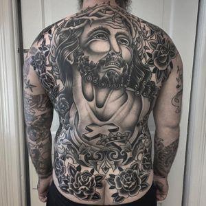 Jesus tattoo by Chris Stuart #ChrisStuart #Jesustattoo #JesusChristtattoo #religioustattoo #religious #Catholic #Christian #portraittattoo #cross #crownofthorns #rose #flower