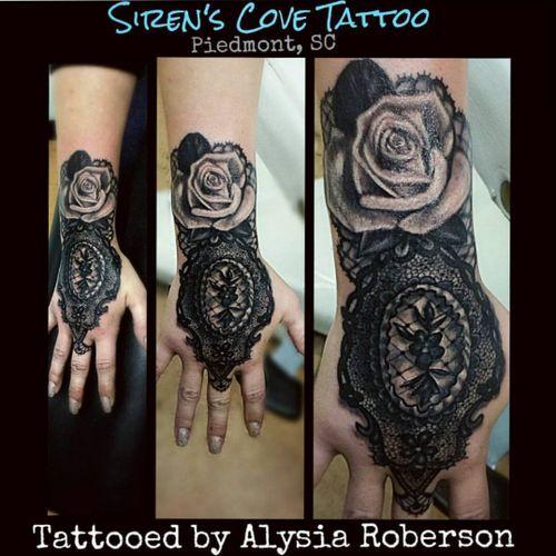 Lace/rose tattoo by Alysia Roberson at Siren's Cove Tattoo in Piedmont ,SC!! #tattoos #tattooed #tattooedwomen #tattooedwoman #tattooedman #tattooedmen #tattooartist #inkedgirl #inkedfemales #inkedgirls #sc #sctattooartist #victoriantattoo  #sctattooist #sctattoo #sctattooshop #sirenscovetattoo #alysiarobersontattoo #femaletattooartist #greenvillesc #andersonsc #victorian #southcarolinatattooartist #clemsontigers #inkmaster #handtattoo #rosetattoo #lace #lacetattoo #realism #realistic  #realistictattoo #gloves #handtatty #blackandgreytattoos #blackandgrey #fingertatoo  #tattooartmagazine #inkedfemales #flowertattoo #girlytattoo #lacey  #laceytattoo   www.facebook.com/Alysia.Roberson.Tattoo.Artist www.facebook.com/sirenscovetattoo