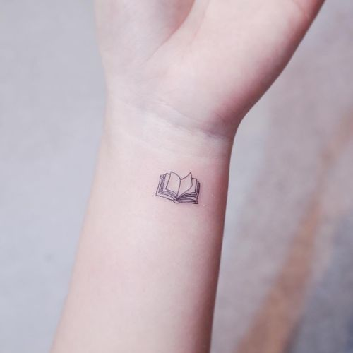 Book tattoo by Whitty Button #WhittyButton #booktattoos #literarytattoos #booktattoo #literarytattoo #books #book #reading #literature