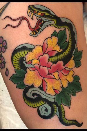 Snake and peony on thigh.
